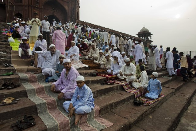 Indian Muslims gather before Eid al-Fitr prayers at the Jama Masjid mosque in New Delhi, India, Saturday, July 18, 2015. (Photo by Bernat Armangue/AP Photo)