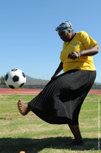 South African grandmothers play football in the Nkowankowa township on November 24, 2009 in Tzaneen, South Africa