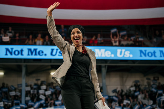 Representative Ilhan Omar (D-MN) waves to the crowd at a campaign rally for Senator (I-VT) and presidential candidate Bernie Sanders at the University of Minnesotas Williams Arena on November, 3, 2019 in Minneapolis, Minnesota. Before introducing him, Rep. Omar praised Sanders for his support of unions, comprehensive immigration reform, and support for refugees. (Photo by Scott Heins/Getty Images)