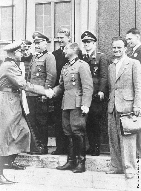 General Erich Fellgiebel, head of the German Army Information Service during World War II, congratulates members of the von Braun rocket team from Peenemunde for their October 3, 1942 A4 flight. Pictured front center is General Erich Fellgiebel