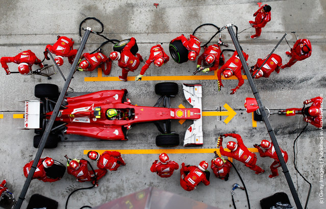 Felipe Massa of Brazil and Ferrari drives in for a pitstop during the Malaysian Formula One Grand Prix at the Sepang Circuit in Kuala Lumpur, Malaysia