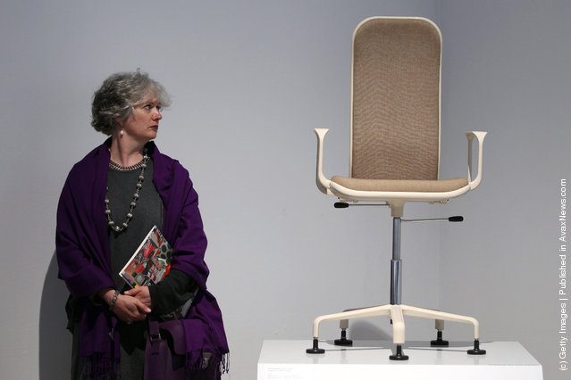 A woman looks at a 60's chair on display at the Victoria and Albert museums' new major exhibition