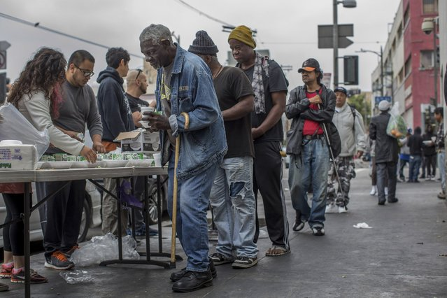Homeless men line up for food being given out on Skid Row in downtown Los Angeles, May 15, 2016. The emergence of an older homeless population is creating daunting challenges for social service agencies and governments already struggling to fight poverty. (Monica Almeida/The New York Times)
