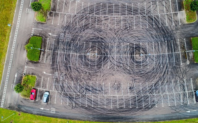 The damage caused by boy racers speeding around lampposts in a Cambridge car park, England was captured by drone on July 30, 2019. (Photo by Geoff Robinson Photography)