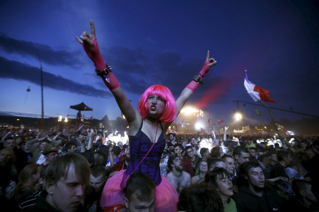 Revelers dance as they listen to the music in front of the main stage during the 21st Woodstock Festival in Kostrzyn-upon-Odra, Poland July 30, 2015. (Photo by Kacper Pempel/Reuters)