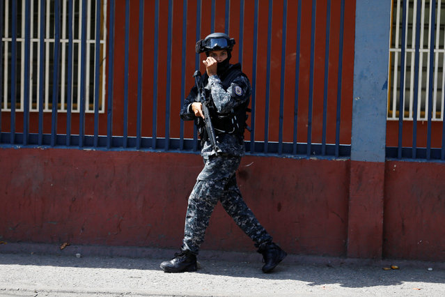 A Venezuelan national guard patrols a street after a protest over food shortage and against Venezuela's government in Caracas, Venezuela, June 10, 2016. (Photo by Ivan Alvarado/Reuters)