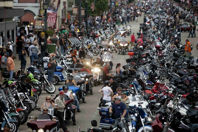 Bikes and rallygoers fill Main Street during the annual Sturgis Motorcycle Rally in Sturgis, South Dakota, August 4, 2015. This year marks the 75th anniversary of the rally expected to draw hundreds of thousands of motorcycle enthusiasts from around the world for events throughout the week-long festival, according to organizers. (Photo by Kristina Barker/Reuters)