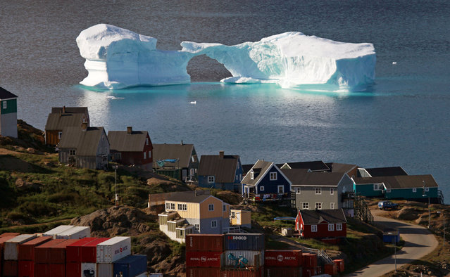 An iceberg floats near a harbour in the town of Kulusuk, east Greenland. (Photo by Bob Strong/Reuters)