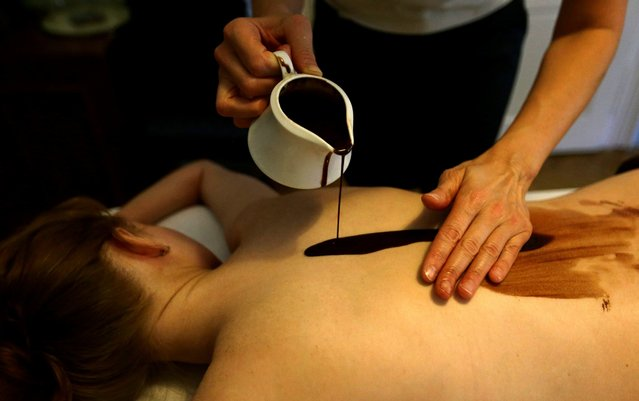 A woman receives a chocolate massage in an aromatherapy salon in Prague, Czech Republic on July 20, 2017. (Photo by David W. Cerny/Reuters)