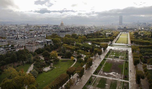 An aerial view shows the Champs de Mars, the Invalides, the Tour Montparnasse and the skyline in Paris, France, October 6, 2015. (Photo by Jacky Naegelen/Reuters)