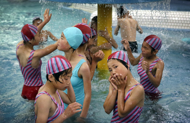 In this Thursday, June 23, 2016, photo, North Korean school children spend their time in the aquatic center at the Songdowon International Children's Camp located in Wonsan, North Korea. The camp, which has been operating for about 30 years, was intended mainly to deepen relations with friendly countries in the Communist or non-aligned world. (Photo by Wong Maye-E/AP Photo)