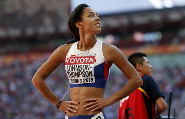 Katarina Johnson-Thompson of Britain looks at the scoreboard after competing in the 100 metres hurdles heats of the women's heptathlon during the 15th IAAF World Championships at the National Stadium in Beijing, China August 22, 2015. (Photo by David Gray/Reuters)