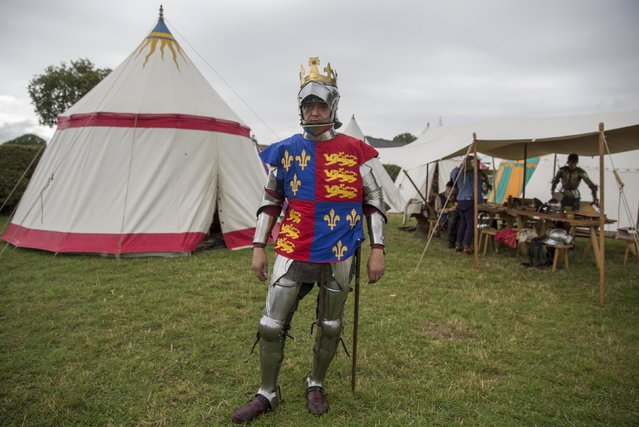Historical re-enactor Andreas Wenzell dresses as Britain's King Richard the third in a living history camp during an anniversary event for the Battle of Bosworth near Market Bosworth in central Britain, August 23, 2015. (Photo by Neil Hall/Reuters)