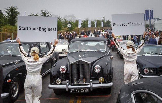 In this photo provided by Rolex, historic automobiles are lined up for the start of the Pebble Beach Tour d'Elegance presented by Rolex, that is part of the Monterey Peninsula's classic car week Thursday, August 14, 2014, in Pebble Beach, Calif. (Photo by Tom O'Neal/AP Photo/Rolex)