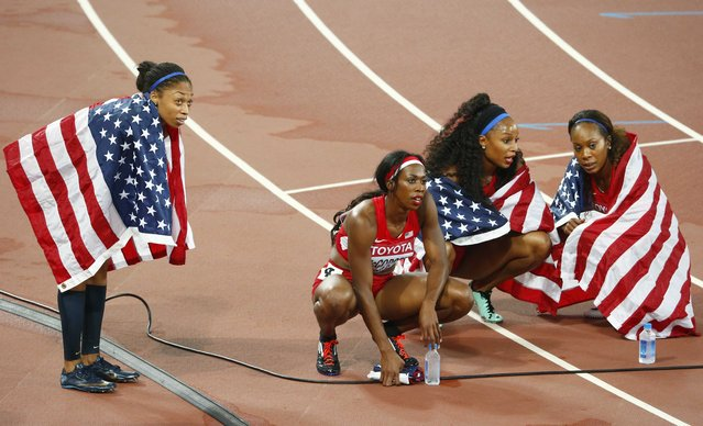 The U.S. team looks at the scoreboard after the women's 4 x 400 metres relay final at the 15th IAAF Championships at the National Stadium in Beijing, China August 30, 2015. (Photo by David Gray/Reuters)