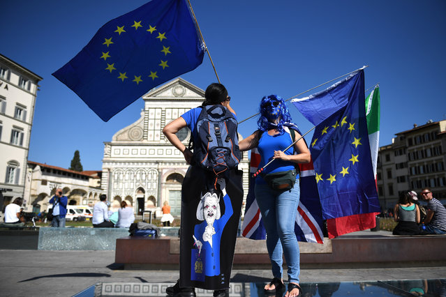 """Demonstrators gather ahead of British Prime Minister Theresa May given her landmark Brexit speech in Complesso Santa Maria Novella on September 22, 2017 in Florence, Italy. She outlined the UK's proposals to the EU in an attempt to break a deadlock ahead of the fourth round of negotiations that begin on Monday. Florence is often referred to as the """"cradle of capitalism"""" known for its historical trading power. (Photo by Jeff J. Mitchell/Getty Images)"""