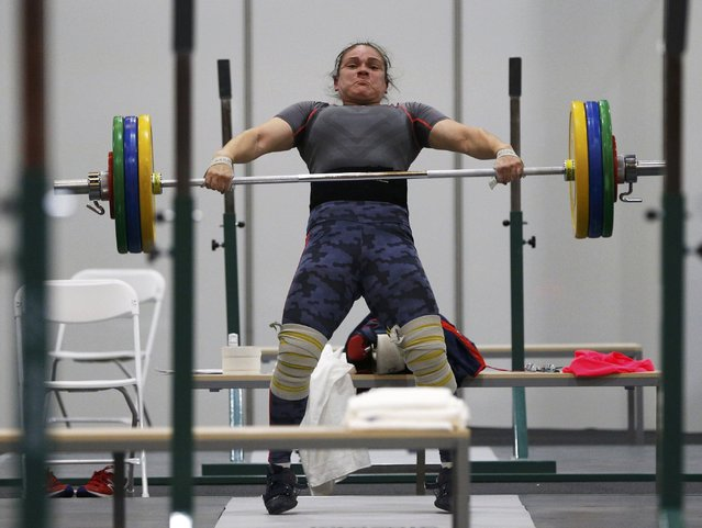 2016 Rio Olympics, Copacabana on July 29, 2016. A weightlifter from Chile practices. (Photo by Athit Perawongmetha/Reuters)