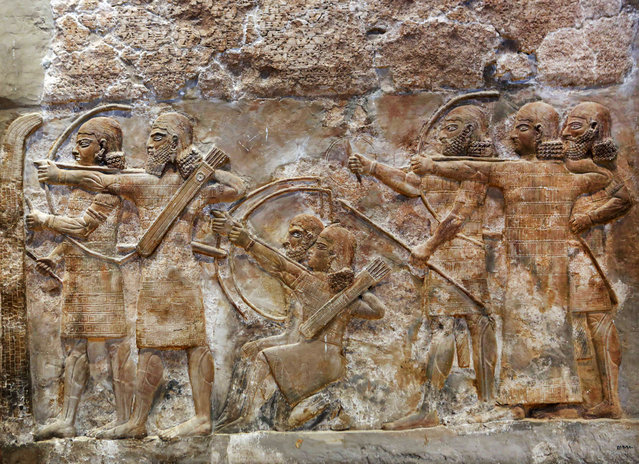 This Monday, September 15, 2014 photo shows bas-relief inscriptions at the Iraqi National Museum in Baghdad. When the Islamic State group overran the northern city of Mosul and surrounding Ninevah province in June, they captured a region were nearly 1,800 of Iraq's 12,000 registered archaeological sites are located. They snapped up even more as they pushed south toward Baghdad. (Photo by Hadi Mizban/AP Photo)