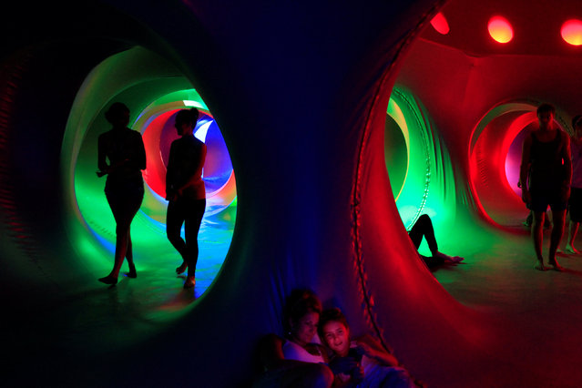 Revellers relax inside a 3-D Luminarium inflatable installation by British designer Alan Parkinson during Sziget music festival on an island in the Danube River in Budapest, Hungary August 14, 2016. (Photo by Bernadett Szabo/Reuters)