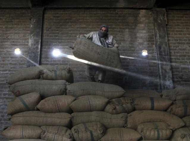 An Afghan man works at a dry fruit factory in Jalalabad, Afghanistan August 25, 2015. (Photo by Reuters/Parwiz)