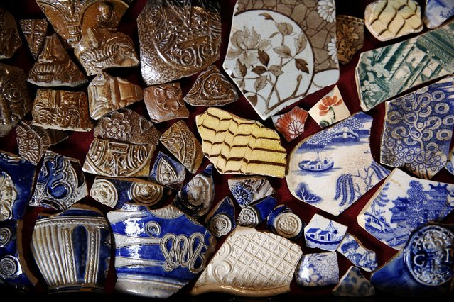A variety of ceramic objects which have been excavated from the River Thames by mudlark Jason Sandy are displayed at his home in London, Britain June 01, 2016. (Photo by Neil Hall/Reuters)