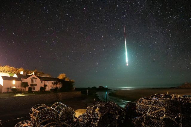 A brightly burning magnesium-rich meteor known as a bolide was captured near Bude, Cornwall on January 24, 2020. (Photo by Chris Small/Apex News)