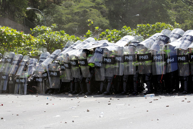 Riot police are seen during clashes with protesters during a rally to demand a referendum to remove Venezuela's President Nicolas Maduro in Caracas, Venezuela, September 1, 2016. (Photo by Marco Bello/Reuters)