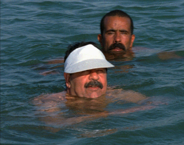 President Saddam Hussein, foreground, swims in the Tigres river from its eastern shore to the western shore on Tuesday, September 16 1997 in this picture provided by the official Iraqi News Agency. The 60-year-old leader swam across the river three times to open a swimming competition held to mark Saddam s 1959 crossing of the river after participating in a failed attempt to assassinate the prime minister at that time, Abdul Karim Kassim. Man in background is unidentified. (Photo by AP Photo/Iraqi News Agency)