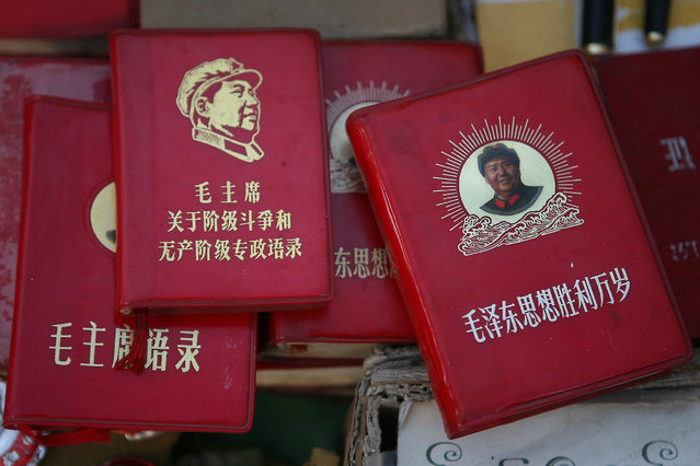 Copies of the Little Red Book are put on display for sale at Panjiayuan flea market in Beijing November 3, 2007. (Photo by Claro Cortes IV/Reuters)