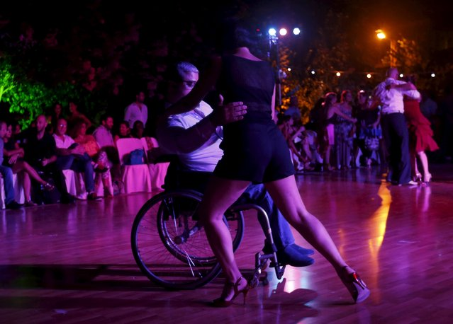 A Lebanese man in a wheelchair performs with his partner during the second International Festival Tango in Byblos, Lebanon, October 3, 2015. (Photo by Jamal Saidi/Reuters)