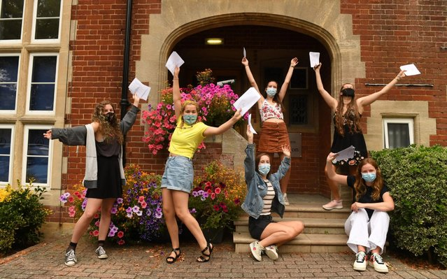 Students at Godolphin School, Salisbury, England, receive their A-Level results on Thursday August 13, 2020. Thousands of school-leaving children in Britain have been left distraught after finding out Thursday that they were given lower-than-expected grades, with many questioning how the results were calculated after the coronavirus pandemic cancelled exams key for college applications. (Photo by Russell Sach/The Telegraph)