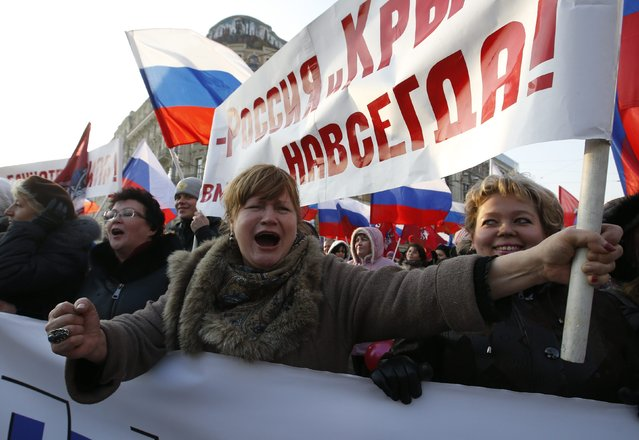 "A woman shouts slogans during a demonstration on National Unity Day in Moscow November 4, 2014. The sign reads, ""Russia and Crimea are together forever"". (Photo by Sergei Karpukhin/Reuters)"