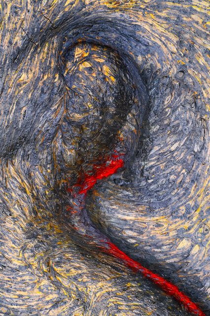 A lava flow erupting at the feet of the photographer during a trek across the Kalapana lava field in Hawaii. (Photo by Mark James Ford/Close Up Photographer of the Year 2020)