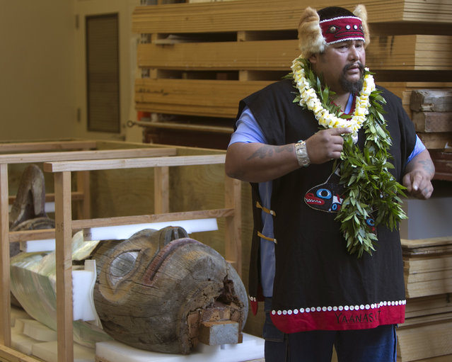 While standing in front of his tribe's totem pole, Tlingit Tribe member from Klawock, Alaska Jonathan Rowan speaks about the significance of the totem pole to his Tribe at the Honolulu Museum of Arts, Thursday, October 22, 2015, in Honolulu. (Photo by Marco Garcia/AP Photo)