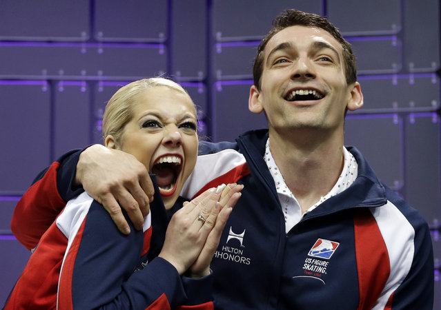 Alexa Scimeca and Chris Knierim, of the United States, react as they watch their scores during the pairs free program at the World Figure Skating Championships Friday, March 15, 2013, in London, Ontario. (Photo by Darron Cummings/AP Photo)