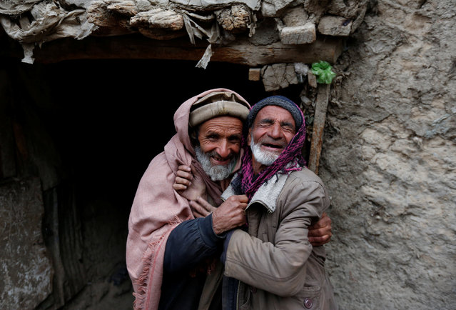 Mirza (R), 65, and Noor Mohammad, 72, pose for a picture at Ka Faroshi bird market in Kabul, Afghanistan, January 18, 2018. (Photo by Mohammad Ismail/Reuters)