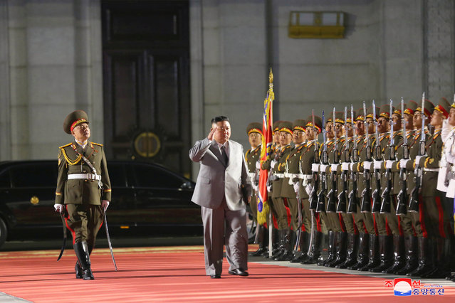 This picture taken on October 10, 2020 and released from North Korea's official Korean Central News Agency (KCNA) on October 11, 2020 shows North Korean leader Kim Jong Un (C) inspecting the ceremonial guard during the ceremony to mark the 75th anniversary of the Workers' Party of Korea at Kim Il-sung Square of Pyongyang. North Korea showed off a gigantic new intercontinental ballistic missile on October 10 that analysts described as the biggest of its kind in the world, as the nuclear-armed country defied the coronavirus threat with thousands of maskless troops taking part in a military parade. (Photo by KCNA via KNS/AFP Photo)