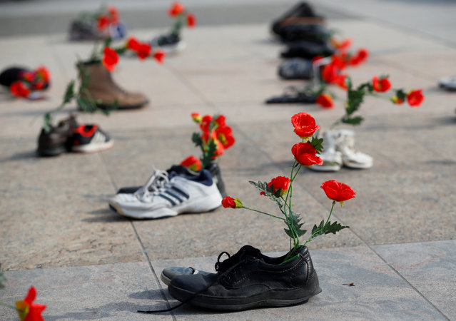 Shoes with flowers are pictured during a demonstration against the speech of Seyyed Ali Reza Avai, Minister of Justice of Iran, at the Human Rights Council, in front of the United Nations in Geneva, Switzerland, February 27, 2018. (Photo by Denis Balibouse/Reuters)