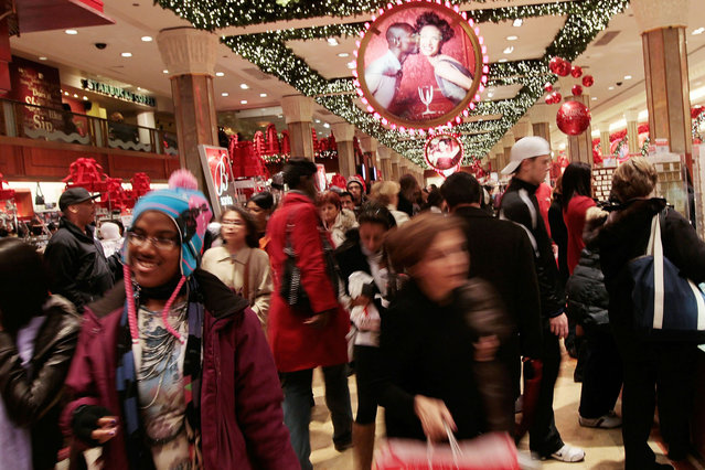 Shoppers move about in Macy's department store in Midtown Manhattan  November 26, 2010 in New York City. Christmas shopping season is officially under way as Thanksgiving ends, and early signs point to a solid turnout for holiday shopping season. (Photo by Chris Hondros/Getty Images)