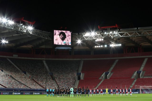 A minute's silence is held in memory of Diego Maradona before the Champions League match between Olympiacos and Manchester City in Piraeus, Greece, November 25, 2020. (Photo by Alkis Konstantinidis/Reuters)