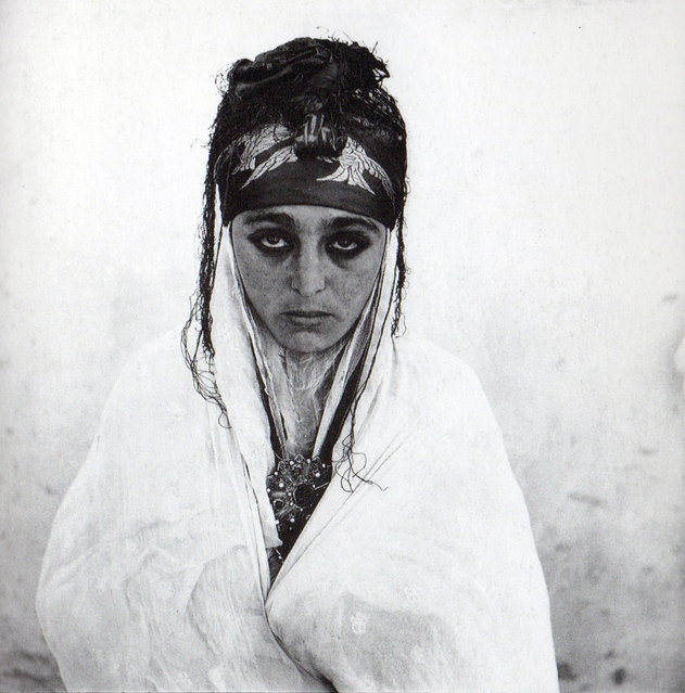 A 1960 photograph of an Algerian woman in a French regroupment village. (Photo by Marc Garanger)