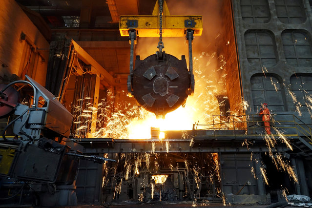 A worker works at a furnace at a steel plant of Dalian Special Steel Co Ltd in Dalian, Liaoning province, China April 8, 2018. (Photo by Reuters/China Stringer Network)