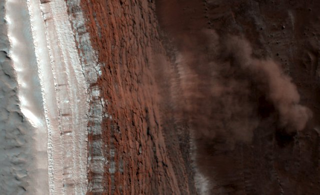This handout shows a false color image, capturing a Martian avalanche or debris fall, in action on Mars North Polar region, which was taken by the High Resolution Imaging Science Experiment (HiRISE) camera on NASA's Mars Reconnaissance Orbiter in this February 19, 2008 file photo. (Photo by Reuters/NASA/JPL-Caltech/University of Arizona)