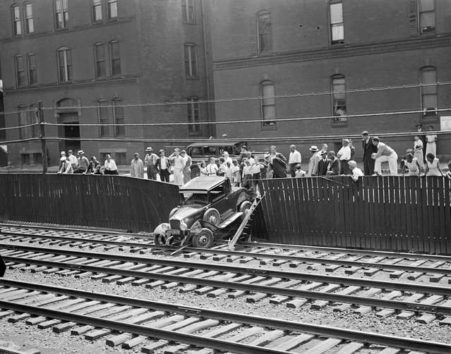 Auto goes out of control and crashes through fence onto B&A Tracks near Greenwich Park, South End, 1934. (Photo by Leslie Jones)