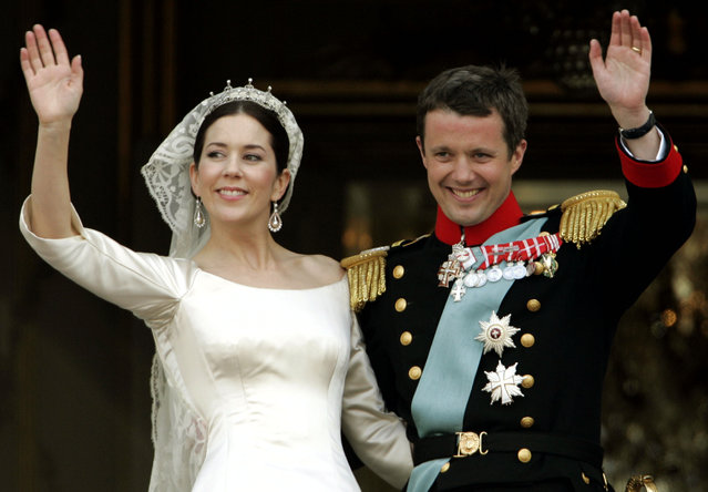 Danish Crown Prince Frederik and his new wife Crown Princess Mary wave from the balcony of Amalienborg Palace following their wedding at the Copenhagen Cathedral, May 14, 2004. (Photo by Wolfgang Rattay/Reuters)
