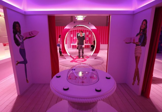 """A visitor stands inside a """"Barbie Dreamhouse"""" of Mattel's Barbie dolls in Berlin, May 16, 201. (Photo by Fabrizio Bensch/Reuters)"""