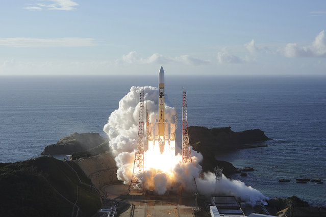 In this photo released by MHI, an H-IIA rocket with United Arab Emirates' Mars orbiter Hope lifts off from Tanegashima Space Center in Kagoshima, southern Japan Monday, July 20, 2020. A United Arab Emirates spacecraft rocketed away Monday on a seven-month journey to Mars, kicking off the Arab world's first interplanetary mission. (Photo by MHI via AP Photo)