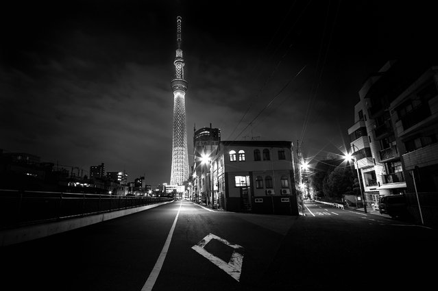 """Night at Skytree"". One cold silent night at the street of oshiage, sumida stand the tallest tower in the world with a tallest structure in Japan and reached its full height of 634.0 metres. Location: 1-1-2 Oshiage, Sumida, Tokyo 131-0045, Japan. (Photo and caption by Danilo Dungo/National Geographic Traveler Photo Contest)"