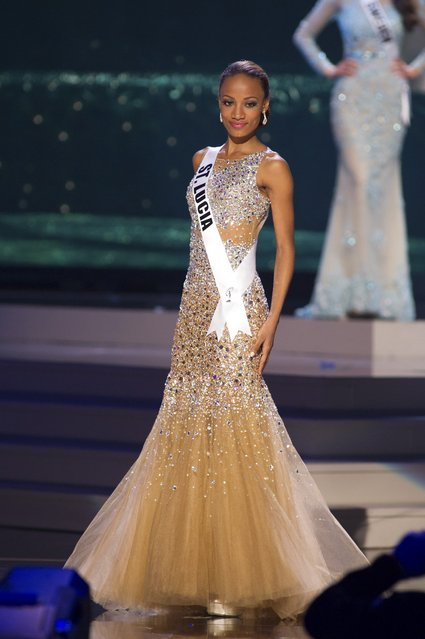 Roxanne Didier-Nicholas, Miss St. Lucia 2014 competes on stage in her evening gown during the Miss Universe Preliminary Show in Miami, Florida in this January 21, 2015 handout photo. (Photo by Reuters/Miss Universe Organization)