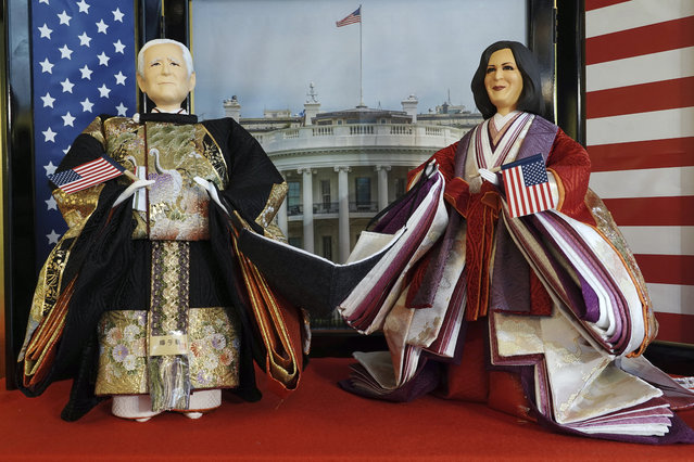 """""""Hina"""" dolls depicting U.S. President Joe Biden and Vice President Kamala Harris, right, are displayed for Girls' Day celebrations at Kyugetsu, a Japanese traditional doll company, Wednesday, January 27, 2021 in Tokyo. The dolls are among others adorned with images based on persons of the year. March 3 is celebrated as Girls' Day to pray for the vigorous growth of girls in the family. (Photo by Eugene Hoshiko/AP Photo)"""